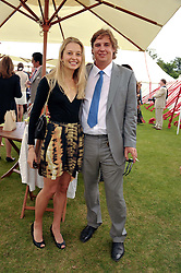 ANTON RUPERT and NINA MALHERBE at the Cartier Queen's Cup Polo Final, Guards Polo Club, Windsor Great Park, Berkshire, on 17th June 2012.