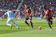 Bournemouth FC midfielder (10) Max Gradel and Bournemouth FC defender (11) Charlie Daniels attempt to get past Manchester City midfielder (15) Jesus Navas during the Barclays Premier League match between Bournemouth and Manchester City at the Goldsands Stadium, Bournemouth, England on 2 April 2016. Photo by Mark Davies.