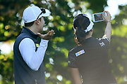 Mi jung Hur (Kor) and his caddie take selfie during the practice round of LPGA Evian Championship 2018, Day 2, at Evian Resort Golf Club, in Evian-Les-Bains, France, on September 11, 2018, Photo Philippe Millereau / KMSP / ProSportsImages / DPPI