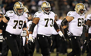 New Orleans Saints guard Jahri Evans (73) walks to the line of scrimmage with the offensive line during the NFL NFC Wild Card football game against the Philadelphia Eagles on Saturday, Jan. 4, 2014 in Philadelphia. The Saints won the game 26-24. ©Paul Anthony Spinelli