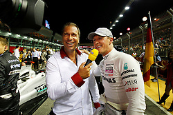 Motorsports / Formula 1: World Championship 2010, GP of Singapore, Kai Ebel (GER, RTL), 03 Michael Schumacher (GER, Mercedes GP Petronas),