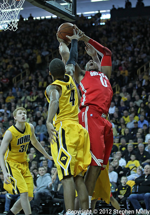 January 07, 2011: Ohio State Buckeyes forward Jared Sullinger (0) puts up a shot as Iowa Hawkeyes guard/forward Roy Devyn Marble (4) defends during the the NCAA basketball game between the Ohio State Buckeyes and the Iowa Hawkeyes at Carver-Hawkeye Arena in Iowa City, Iowa on Saturday, January 7, 2012.