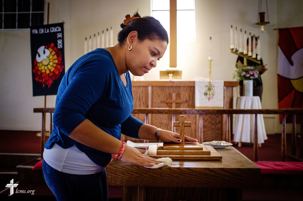 Yadira Lozano Odio, a new Cuban immigrant to the United States, gently cleans the baptismal font in preparation for several baptisms at San Pablo Lutheran Church on Sunday, May 22, 2016, in El Paso, Texas. LCMS Communications/Erik M. Lunsford
