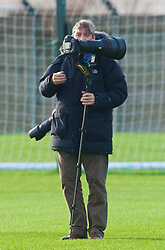 LIVERPOOL, ENGLAND - Tuesday, December 8, 2009: Getty Images photographer John Powell during a Liverpool training session at Melwood ahead of the UEFA Champions League Group E match against AFC Fiorentina. (Pic by David Rawcliffe/Propaganda)