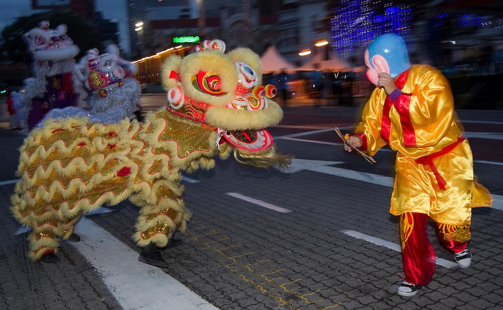 Lion dance performing wth 'Big Head Buddha', Kuala Lumpur, Malaysia.