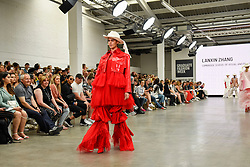 © Licensed to London News Pictures. 02/06/2019. LONDON, UK.  A model presents a look by Lanxin Zhang from Cambridge School of Visual and Performing Arts in the GFW Collective show on day one of Graduate Fashion Week taking place at the Old Truman Brewery in East London.  The event presents the graduation show of up and coming fashion designers from UK and international universities.  Photo credit: Stephen Chung/LNP