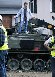 ©  licensed to London News Pictures. 01/07/2011. Gravesend, Kent. Richard Hammond standing on a tank. Top Gear presenters Jeremy Clarkson, James May and Richard Hammond smashing up old houses in Gravesend, Kent with tanks during filming for Top Gear today (01/07/2011). See special instructions. Photo credit Grant Falvey/LNP.