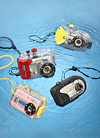 four underwater cameras on a blue background