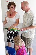 PRICE CHAMBERS / NEWS&amp;GUIDE<br /> Jim and Lisa discover some new cleaning supplies left for them in their new garage.