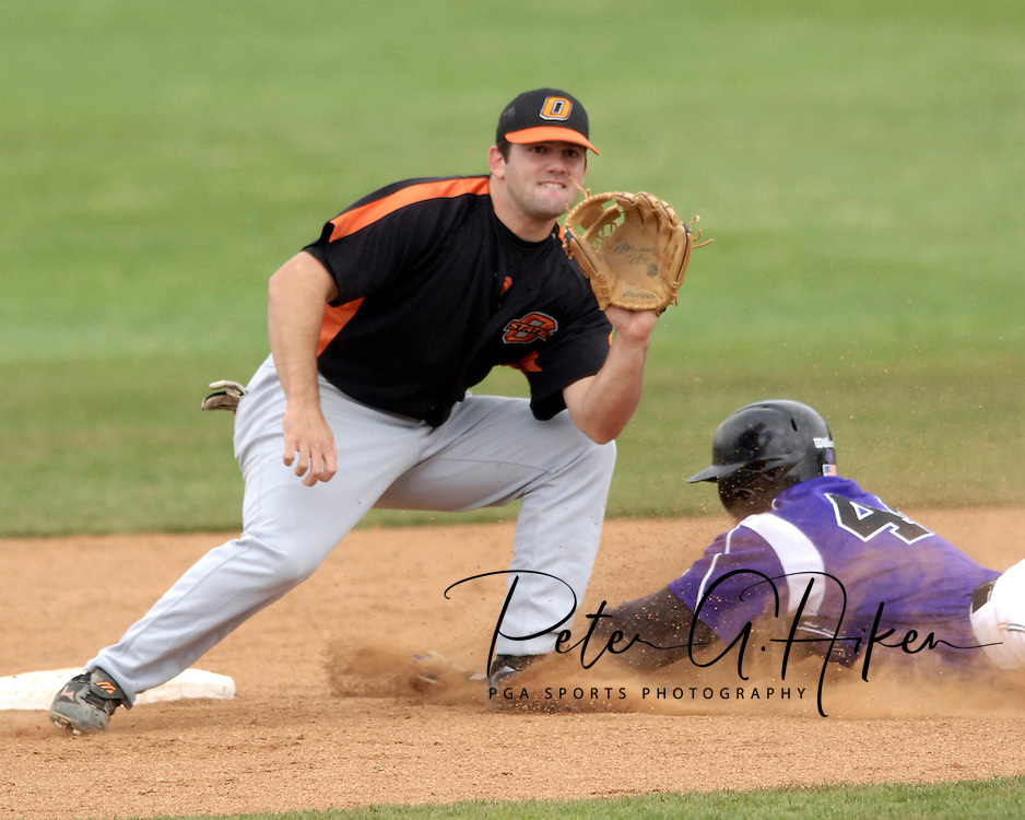 Oklahoma State second basemen Justin Colbert (C) covers second base, as Kansas State's Joe Roundy (R) steals the base.  Oklahoma State defeated K-State 9-4 in 10 innings at Tointon Stadium in Manhattan, Kansas, April 30, 2006.