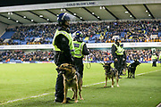police and dogs on the pitch after Millwall win during the The FA Cup fourth round match between Millwall and Everton at The Den, London, England on 26 January 2019.