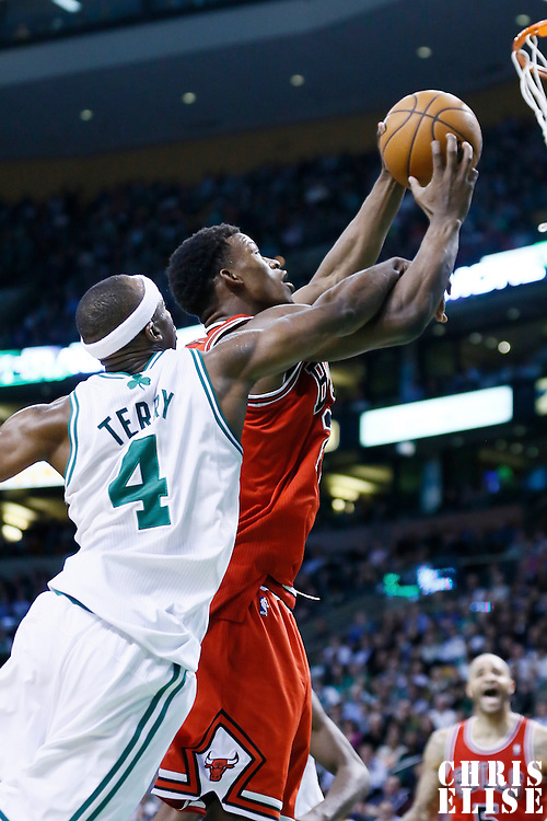 13 February 2013: Chicago Bulls small forward Jimmy Butler (21) is fouled by Boston Celtics shooting guard Jason Terry (4) during the Boston Celtics 71-69 victory over the Chicago Bulls at the TD Garden, Boston, Massachusetts, USA.