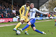 Bury Midfielder, Danny Mayor and Millwall Midfielder, Mahlon Romeo battle during the Sky Bet League 1 match between Bury and Millwall at the JD Stadium, Bury, England on 23 April 2016. Photo by Mark Pollitt.