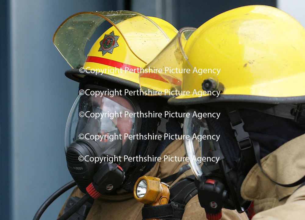 Tayside Fire Brigade<br />Firefighters training in the 'Real Fire Training' centre at Perth Fire Station.<br /><br />Picture by Graeme Hart.<br />Copyright Perthshire Picture Agency<br />Tel: 01738 623350  Mobile: 07990 594431