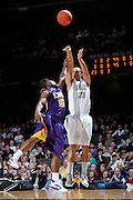 NASHVILLE, TN - FEBRUARY 8: John Jenkins #23 of the Vanderbilt Commodores shoots over Andre Stringer #10 of the LSU Tigers at Memorial Gymnasium on February 8, 2012 in Nashville, Tennessee. Vanderbilt defeated LSU 76-61. (Photo by Joe Robbins) *** Local Caption *** John Jenkins;Andre Stringer