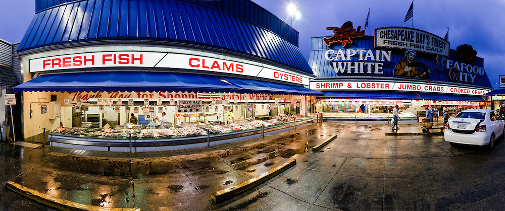 Panorama of Washington DC's Maine Avenue Fish Market on the Southwest waterfront at night. It's the oldest continuing operating fish market in the United States.
