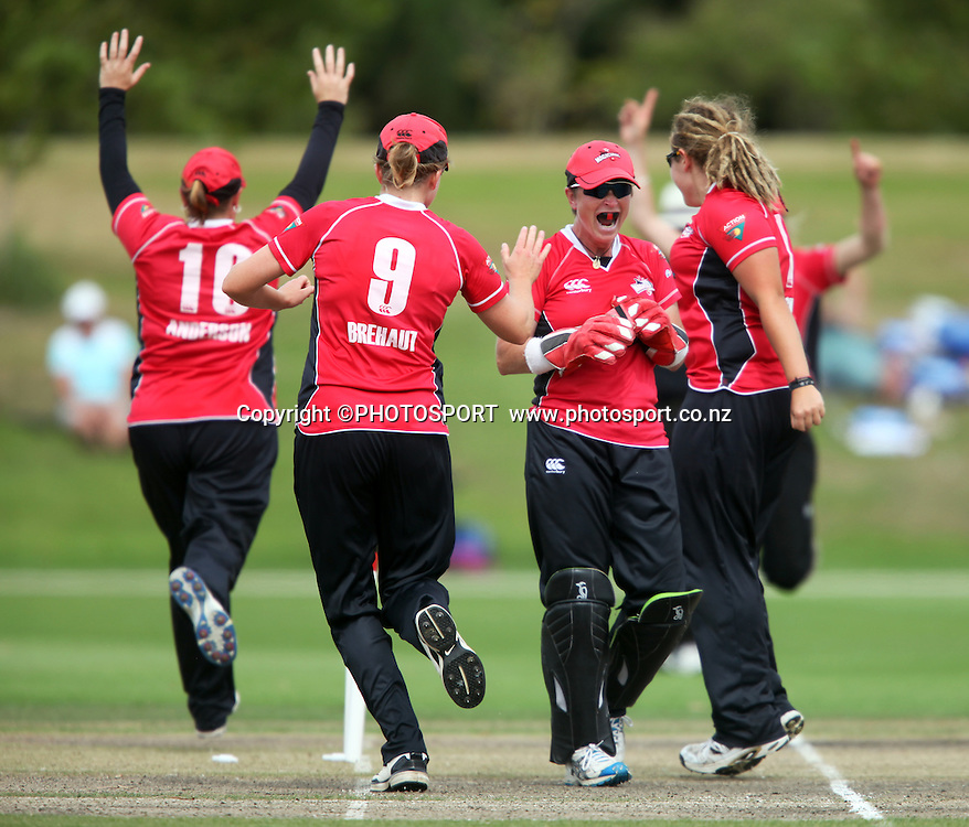 Canterbury wicket keeper Mandie Godliman celebrates the run out of Wellington's Liz Perry with team mates. Canterbury Magicians v Wellington Blaze in the Action Cricket Cup Final. Women's Cricket. QEII Park, Christchurch, New Zealand. Sunday, 30 January 2011. Joseph Johnson / PHOTOSPORT.