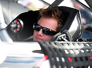 Nov. 12 2011; Avondale, AZ, USA; NASCAR Nationwide Series driver Steve Wallace (38) sits in his car during qualifying for the Wypall 200 at Phoenix International Raceway. Mandatory Credit: Jennifer Stewart-US PRESSWIRE