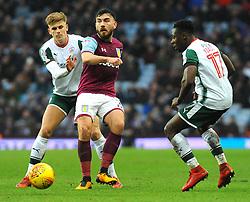 Robert Snodgrass of Aston Villa under pressure from Brad Potts of Barnsley- Mandatory by-line: Nizaam Jones/JMP - 20/01/2018 - FOOTBALL - Villa Park - Birmingham, England - Aston Villa v Barnsley- Sky Bet Championship