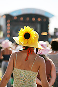 The back of a woman wearing a flower in her hat, Nokia Isle of Wight Festival, Sealclose Park, Newport, UK June 2006