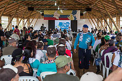 El Diamante, Meta, Colombia - 19.09.2016        <br /> <br /> On the third day of the FARC conference media representatives were able to photograph and film five minutes in the discussion area. The discussions of the conference held in a non-public context, in a zone where otherwise only delegates have access.  The  of the 10th conference of the marxist FARC-EP in El Diamante, a Guerilla controlled area in the Colombian district Meta. Few days ahead of the peace contract passing after 52 years of war with the Colombian Governement wants the FARC decide on the 7-days long conferce their transformation into a unarmed political organization. <br /> <br /> Am zweiten Tag der FARC Konferenz konnten Medienvertreter 5 Minuten im Diskussionsbereich fotografieren und filmen. Die Gespraeche der Konferenz finden in einem nicht ˆffentlichen Rahmen statt, in einem Gel‰ndeteil zu dem ansonsten nur die Delegierten Zutritt haben. Zehnten Konferenz der marxistischen FARC-EP in El Diamante, einem von der Guerilla kontrollierten Gebiet im kolumbianischen Region Meta. Wenige Tage vor der geplanten Verabschiedung eines Friedensvertrags nach 52 Jahren Krieg mit der kolumbianischen Regierung will die FARC auf ihrer sieben taegigen Konferenz die Umwandlung in eine unbewaffneten politischen Organisation beschlieflen. <br />  <br /> Photo: Bjoern Kietzmann