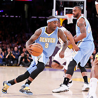 23 November 2014: Denver Nuggets guard Ty Lawson (3) drives past Los Angeles Lakers guard Ronnie Price (9) during the Los Angeles Lakers season game versus the Denver Nuggets, at the Staples Center, Los Angeles, California, USA.
