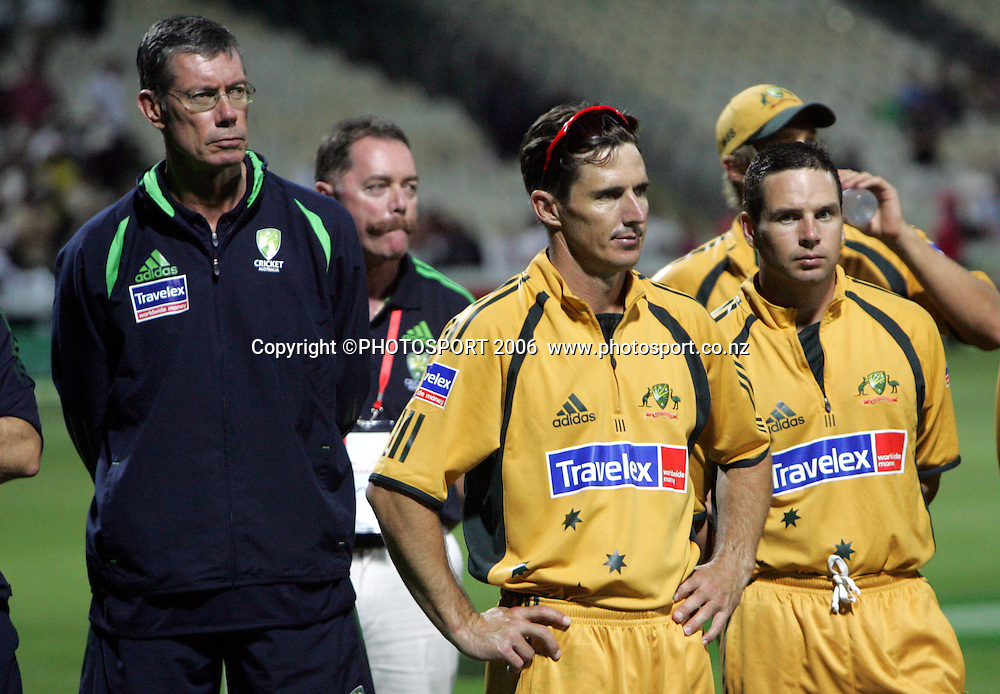 L-R Australian coach John Buchanan, players Brad Hogg and Brad Hodge look on at the post match presentation after New Zealand won the match by 1 wicket chasing Australia's 346 during the 3rd Chappell Hadlee one day match at Seddon Park, Hamilton, New Zealand on Tuesday 20 February 2007. New Zealand won the series 3-0. Photo: Andrew Cornaga/PHOTOSPORT<br /><br /><br />200207