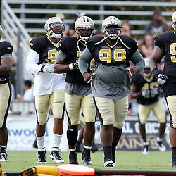August 5, 2011; Metairie, LA, USA; New Orleans Saints defensive lineman Shaun Rogers (92), Aubrayo Franklin (99), Tom Johnson (72), Turk McBride (90), and Camron Jordan (94) during training camp practice at the New Orleans Saints practice facility. Mandatory Credit: Derick E. Hingle