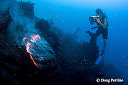videographer Shane Turpin, films pillow lava at underwater eruption of Kilauea Volcano, Hawaii Island <br /> (&quot; the Big Island &quot;), Hawaii, U.S.A. ( Central Pacific Ocean ) <br /> MR 382