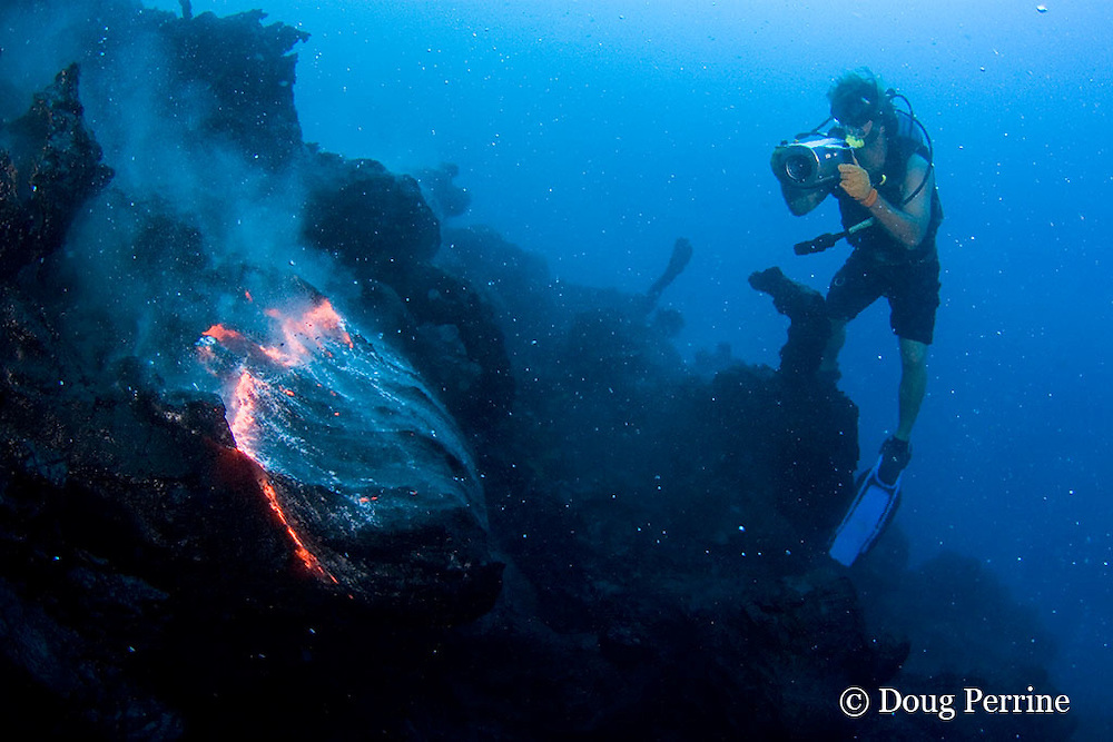 "videographer Shane Turpin, films pillow lava at underwater eruption of Kilauea Volcano, Hawaii Island <br /> ("" the Big Island ""), Hawaii, U.S.A. ( Central Pacific Ocean ) <br /> MR 382"