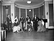"""27/06/1959<br /> 06/27/1959<br /> 27 June 1959<br /> Gael Linn Cabaret at Bundoran. The finale to the Cabaret, as Liam Devally, right sings """"Sile Nic Ire"""" to Sean Maguire's accompaniment. Included (l-r) are: Diarmuid O'Broin, Compere and Gael Linn National Organiser; Fionnuala O'Suilleabhain, singer; Gertie Mc Cormack, Champion Traditional Dancer; Sean Maguire, """"Progressive"""" Traditional Fiddler; Breandan O'Dubhghaill, Singer; Kathleen Watkins, R.E. Harpist and Singer; Liam Devally, R.E. Tenor and Aine Nic Canas, R.E. Singer."""