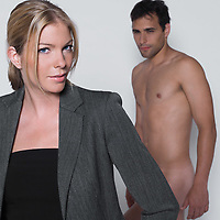 woman seductress with man naked in studio on isolated grey background
