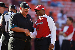 October 10, 2010; San Francisco, CA, USA;  Philadelphia Eagles head coach Andy Reid (left) shakes hands with San Francisco 49ers head coach Mike Singletary (right) before the game at Candlestick Park.