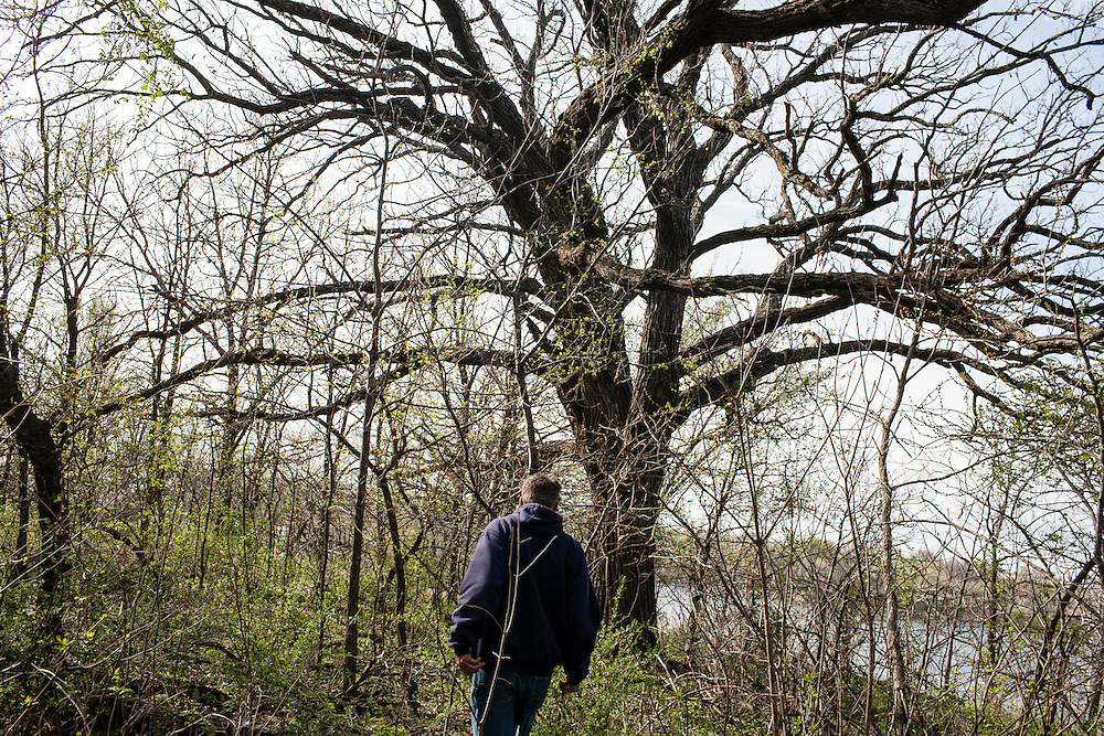 John Reinsel hunts for morel mushrooms on Thursday, March 29, 2012 in Webster City, IA. Reinsel worked at Electrolux for 31 years before being laid off in 2011.