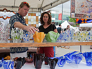 Bruce and Jennifer McDonald (from left) of Iowa City look at a kiln fused vase at the Evergreen Glass Works booth at Iowa Arts Festival in Iowa City on Saturday, June 5, 2010. Over 125 artists had booths at the event which runs through Sunday. Other activities include live music, children's activities, and food booths.