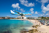 People at Maho Beach watch a KLM Boeing 747 come in for a landing at Princess Juliana International Airport in St. Maarten.