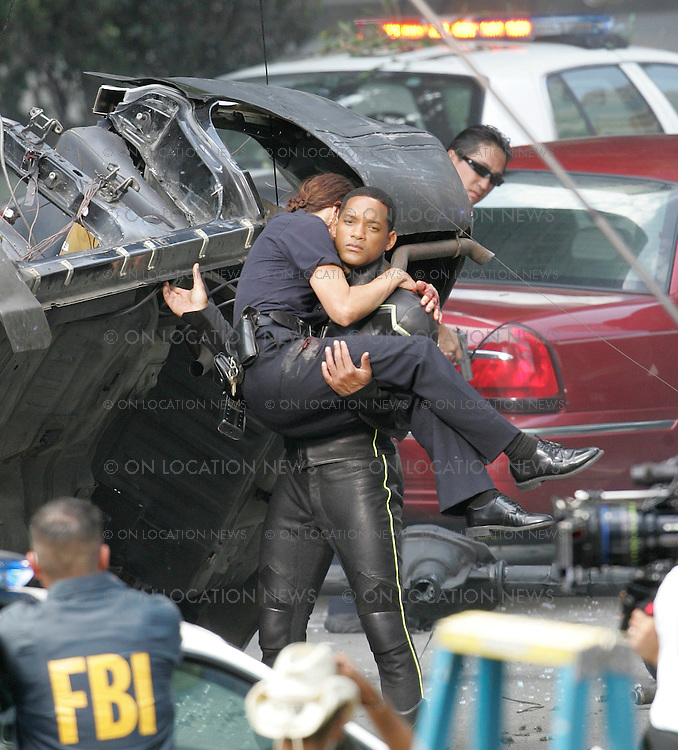 Los Angeles, California - Tuesday August 05, 2007. EXCLUSIVE: Will Smith films a scene for Hancock. In the scene Will Smith is a superhero who saves an injured female cop and innocent hostages from a bank robbery. In the scene, even though Will saves the day he is booed by the crowd of onlookers and media after he exits the bank with the severed hand of one of the bad guys who threatened to blow up hostages. They think the day was saved but done in poor taste. Photograph:Ford/Buchan/On Location News. Sales: Eric Ford 1/818-613-3955 info@onlocationnews.com