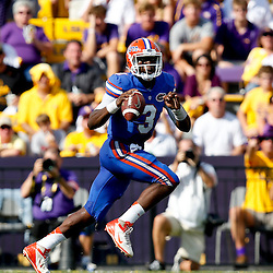 Oct 12, 2013; Baton Rouge, LA, USA; Florida Gators quarterback Tyler Murphy (3) runs against the LSU Tigers during the first half of a game at Tiger Stadium. Mandatory Credit: Derick E. Hingle-USA TODAY Sports
