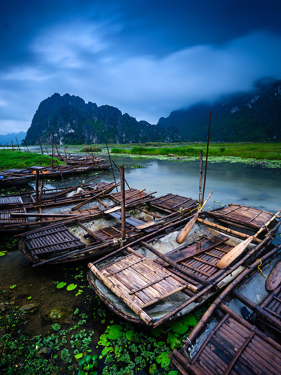 NINH BINH, VIETNAM - CIRCA APRIL 2019:  Rowing boats over the Van Long Nature Reserve and Wetlands near Ninh Binh.