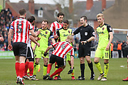 Lincoln City and Exeter City players have an altercation during the EFL Sky Bet League 2 match between Lincoln City and Exeter City at Sincil Bank, Lincoln, United Kingdom on 30 March 2018. Picture by Mick Atkins.