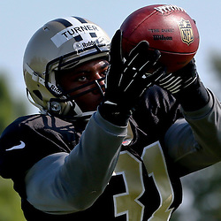 Jul 29, 2013; Metairie, LA, USA; New Orleans Saints cornerback Dion Turner (31) catches a pass during a morning training camp practice at the team facility.  Mandatory Credit: Derick E. Hingle-USA TODAY Sports