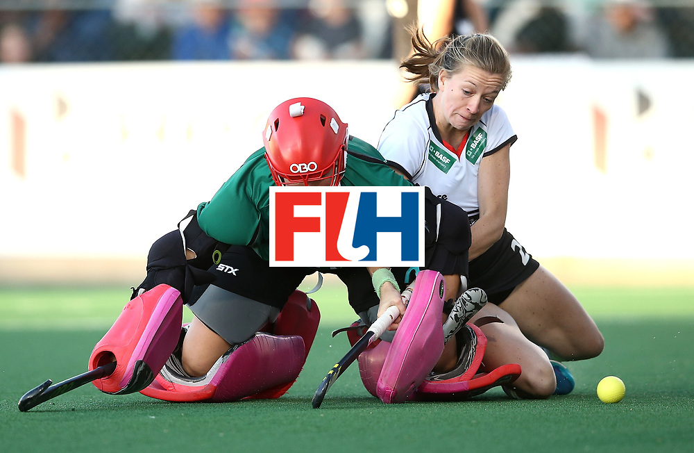 JOHANNESBURG, SOUTH AFRICA - JULY 23:  Jackie Briggs, goalkeeper of United States of America saves a shot from Franziska Hauke of Germany during day 9 of the FIH Hockey World League Women's Semi Finals final match between X at Wits University on July 23, 2017 in Johannesburg, South Africa.  (Photo by Jan Kruger/Getty Images for FIH)