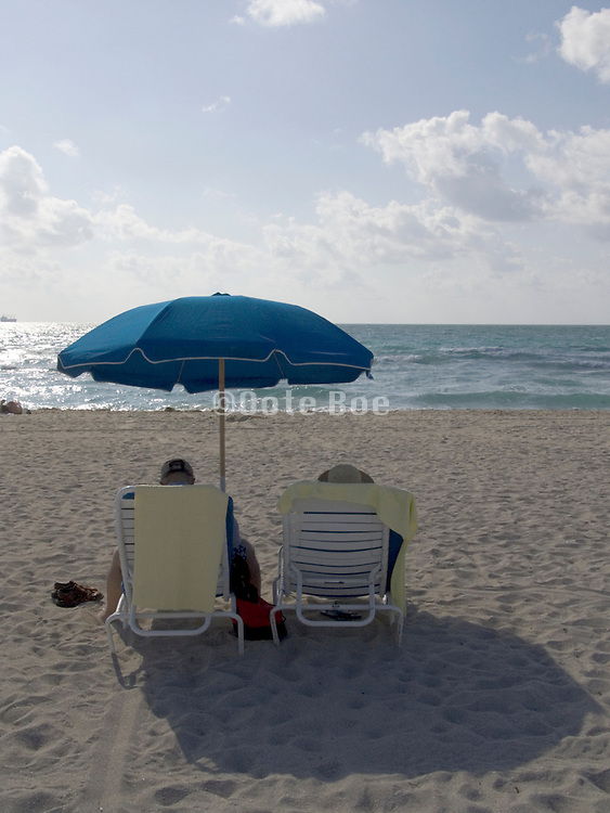 couple having a leisurely day one the beach Miami USA