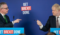 © Licensed to London News Pictures. 29/11/2019. London, UK. Prime Minister Boris Johnson and Michael Gove face each other during a press conference in London. Later a seven way TV election debate will take place with senior politicians in Cardiff. Photo credit: Peter Macdiarmid/LNP