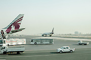 Passengers boarding Qatar Airlines at Doha airport. Doha, Qatar.
