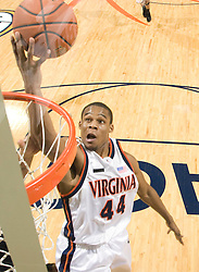 Virginia guard Sean Singletary (44) shoots a layup at the end of the game after stealing the ball from Old Dominion guard Brandon Johnson (4) to seal UVA's victory over ODU.  The Virginia Cavaliers men's basketball team defeated the Old Dominion Monarchs 80-76 in the second round of the College Basketball Invitational (CBI) at the University of Virginia's John Paul Jones Arena in Charlottesville, VA on March 24, 2008.