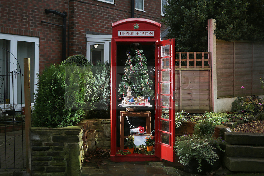 © Licensed to London News Pictures. 15/12/2016. Upper Hopton, UK. A phonebox has had a christmas conversion in the village of Upper Hopton in West Yorkshire. Inside the phonebox there is a christmas tree, a toy train, which can be activated at the push of a button, and many other lights and decorations. The display is the work of local man John Broscombe. The disused phone box bought by the community for just £1 has proved a focal point for the village – helping to promote local events and raising a smile with a series of animated displays at different times of the year. Photo credit : Ian Hinchliffe/LNP