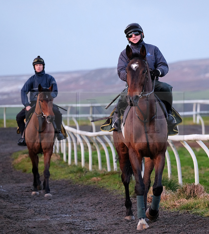 &copy; Licensed to London News Pictures. <br /> 11/12/2014. <br /> <br /> Middleham, United Kingdom<br /> <br /> Jockeys head out on racehorses for their first training session of the day at the gallops at Middleham in Yorkshire as winter weather continues to affect many parts of the country. The traditional racehorse training at Middleham gallops has played a major part in producing some of the finest racehorses in the country.<br /> <br /> <br /> Photo credit : Ian Forsyth/LNP