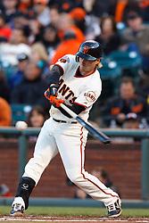 May 24, 2011; San Francisco, CA, USA;  San Francisco Giants second baseman Mike Fontenot (14) at bat against the Florida Marlins during the second inning at AT&T Park. Florida defeated San Francisco 5-1.