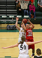 City High's Mickey Hansche (23) puts up a shot during the 2013 Eastern Iowa All-Star Basketball Game at Iowa City West High School in Iowa City on Wednesday, March 27, 2013. The North (white) defeated the South (dark) 68-65.